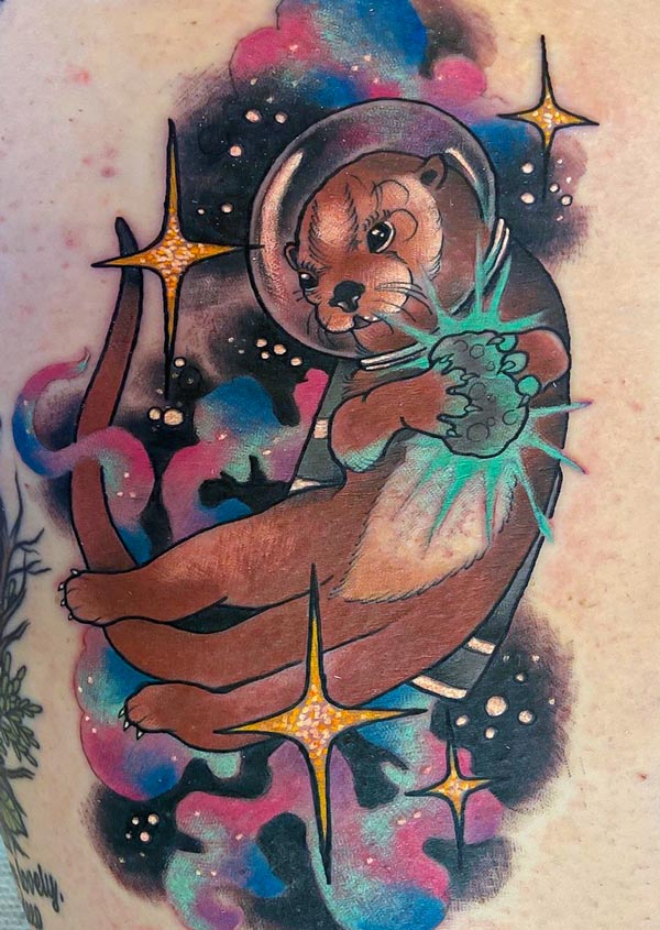 Lauren's colorful Otter Space Tattoo